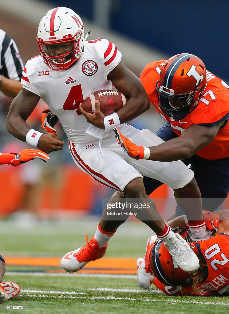 Tommy Armstrong Jr. #4 of the Nebraska Cornhuskers runs the ball and is tackled by Clayton Fejedelem #20 and Jihad Ward #17 of the Illinois Fighting Illini at Memorial Stadium on October 3, 2015 in Champaign, Illinois. Illinois defeated Nebraska 14-13.