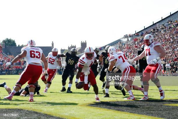 Tommy Armstrong Jr #4 of the Nebraska Cornhuskers rushes for a threeyard touchdown in the first quarter against the Purdue Boilermakers during the...