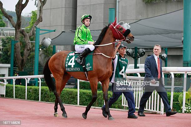 Tommy Berry on Military Attack leaves the parade ring for the start of the Audemars Piguet Queen Elizabeth II Cup during the Audemars Piguet Queen...