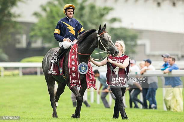 Tommy Berry riding Chautauqua celebrates after winning The Chairman's Sprint Prize race at Sha Tin Racecourse on May 1 2016 in Hong Ko