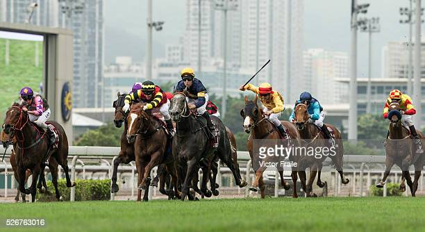 Tommy Berry riding Chautauqua on their way to win The Chairman's Sprint Prize race at Sha Tin Racecourse on May 1 2016 in Hong Ko