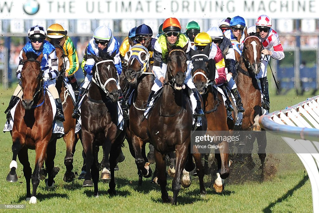 Tommy Berry riding Glencadam Gold (r) suffers interference in the first lap during the start of the BMW Caulfield Cup during Caulfield Cup day at Caulfield Racecourse on October 19, 2013 in Melbourne, Australia.