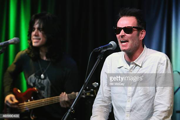 Tommy Black and Scott Weiland of Scott Weiland and the Wildabouts perform at Radio 1045 Performance Theater March 12 2015 in Bala Cynwyd Pennsylvania