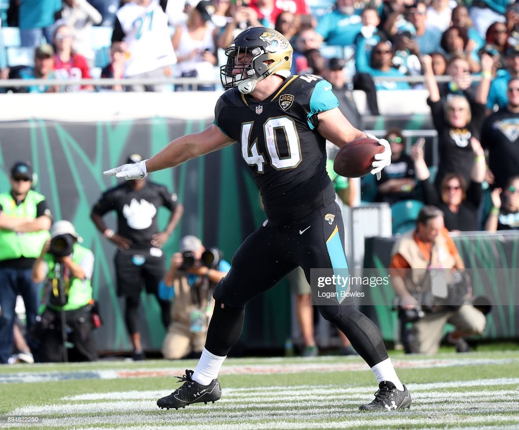 Tommy Bohanon #40 of the Jacksonville Jaguars celebrates after a 1-yard touchdown run during the second half of their game against the Houston Texans at EverBank Field on December 17, 2017 in Jacksonville, Florida.