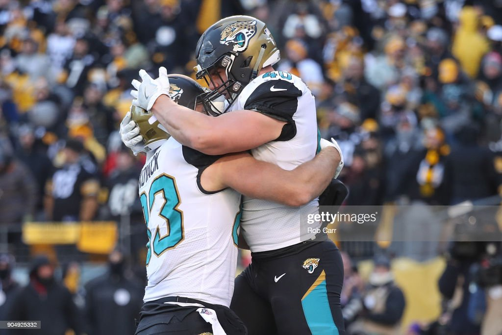 Tommy Bohanon #40 of the Jacksonville Jaguars celebrates with Ben Koyack #83 after a touchdown against the Pittsburgh Steelers during the second half of the AFC Divisional Playoff game at Heinz Field on January 14, 2018 in Pittsburgh, Pennsylvania.