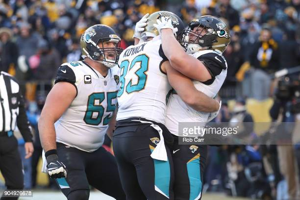 Tommy Bohanon of the Jacksonville Jaguars celebrates with Ben Koyack and Brandon Linder after a touchdown against the Pittsburgh Steelers during the...