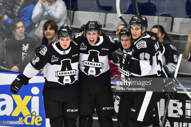 Tommy Bouchard of the Blainville-Boisbriand Armada celebrates a second period goal with teammates Yaroslav Likhachev, Miguel Tourigny and Samuel...
