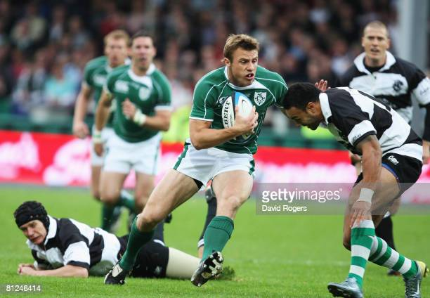 Tommy Bowe of Ireland breaks past Soseni Anesi of the Barbarians on the way to scoring the opening try during the International Friendly match...