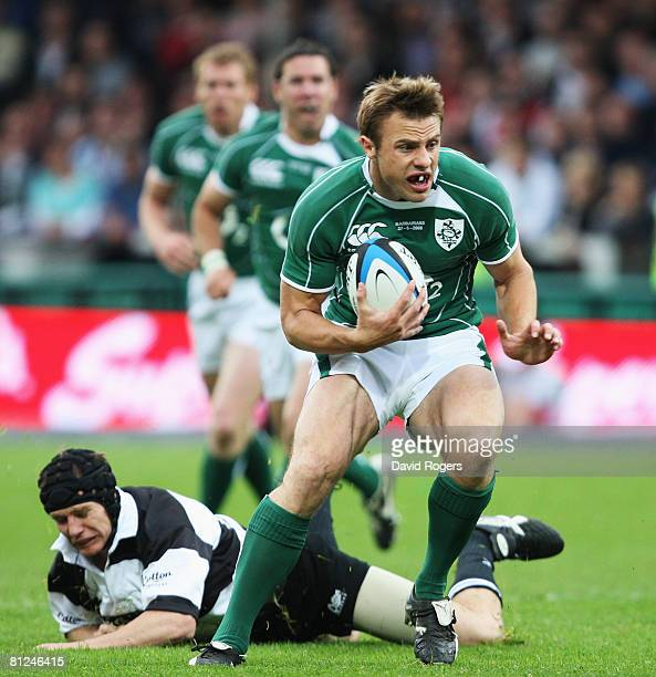 Tommy Bowe of Ireland breaks through the Barbarians defence on the way to scoring the opening try during the International Friendly match between the...