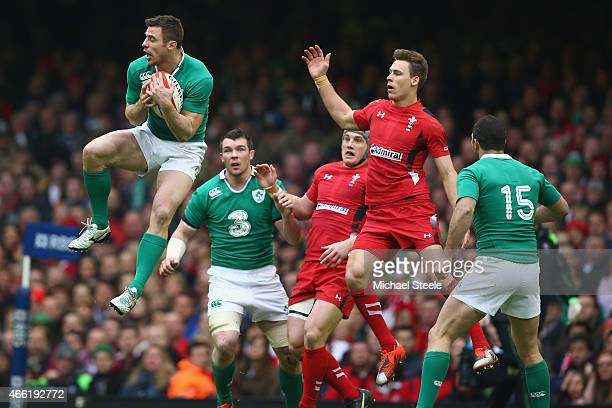 Tommy Bowe of Ireland claims a high ball from Liam Williams of Wales during the RBS Six Nations match between Wales and Ireland at the Millennium...