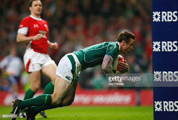 Tommy Bowe of Ireland goes over to score a try during the RBS 6 Nations Championship match between Wales and Ireland at the Millennium Stadium on...