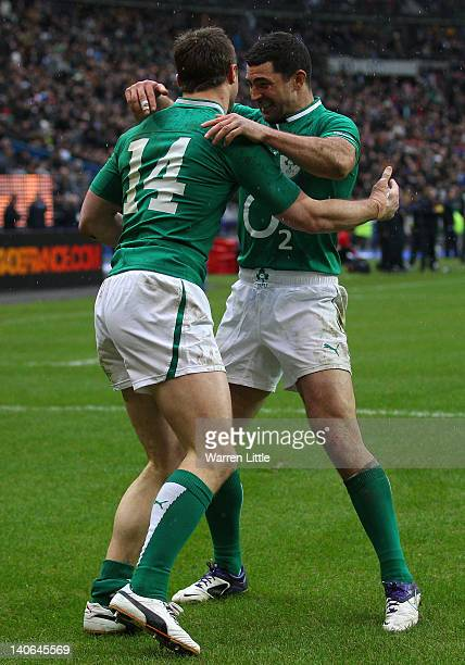 Tommy Bowe of Ireland is congratulated by team mate Rob Kearney after scoring his second try during the RBS Six Nations match between France and...