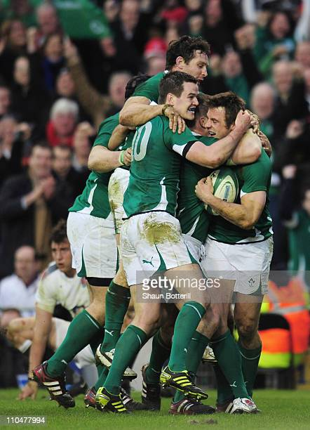Tommy Bowe of Ireland is congratulated by teammate Jonathan Sexton after scoring during the RBS 6 Nations match between Ireland and England at the...