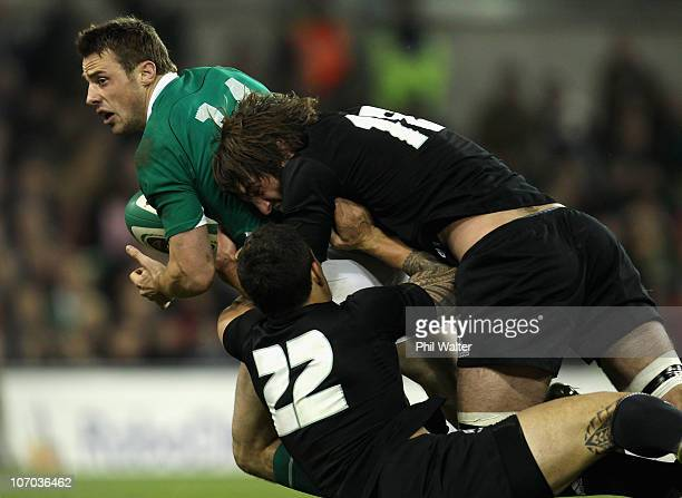 Tommy Bowe of Ireland is tackled by Sonny Bill Williams and Sam Whitelock of the All Blacks during the Test match between Ireland and the New Zealand...