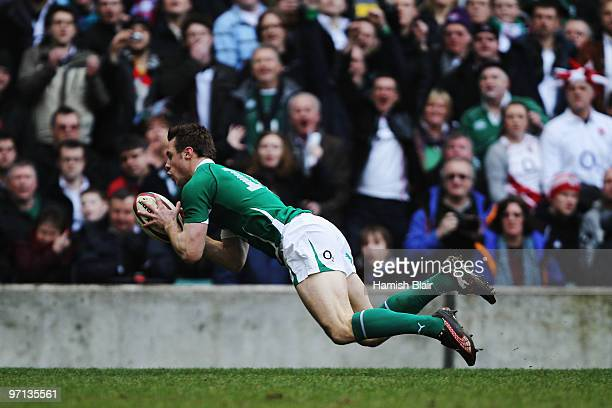 Tommy Bowe of Ireland scores a try during the RBS Six Nations match between England and Ireland at Twickenham Stadium on February 27 2010 in London...