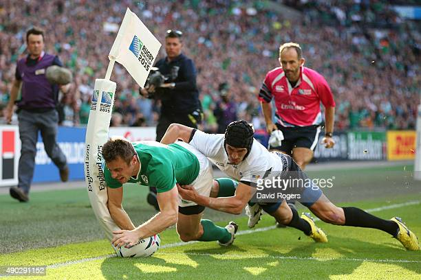Tommy Bowe of Ireland scores his teams first try during the 2015 Rugby World Cup Pool D match between Ireland and Romania at Wembley Stadium on...