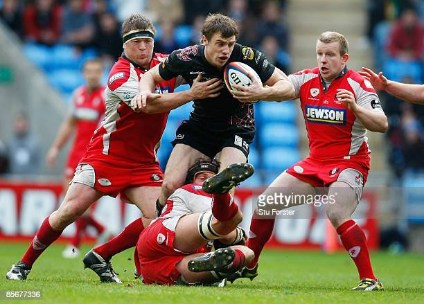 Tommy Bowe of the Ospreys is wrapped up by the Gloucester defence during the EDF Energy Cup Semi Final between Gloucester and Ospreys at the Ricoh...