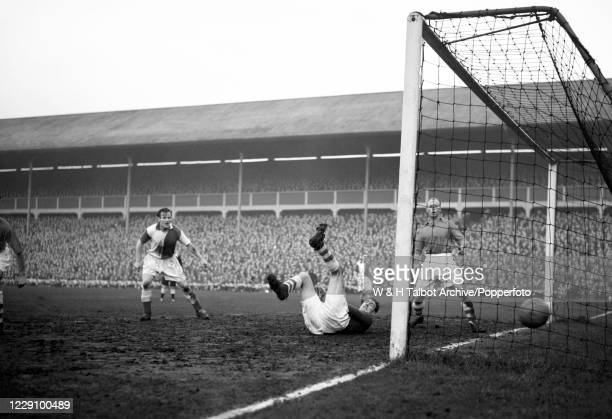 Tommy Briggs of Blackburn Rovers scores during a Football League Division Two match at Ewood Park in Blackburn, England, circa 1956.