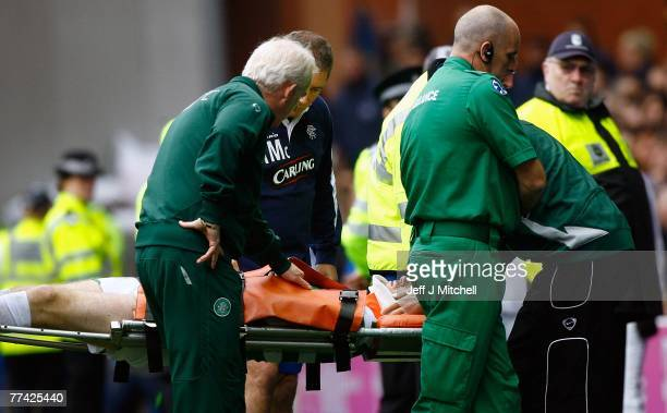 Tommy Burns and Ally McCoist check on Stephen McManus of Celtic as he taken from the field on a stretcher during the Scottish Premier League match...