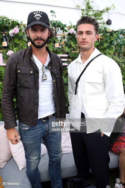 Tommy Clarke and Harvey NewtonHaydon attend Veuve Clicquot's Brose on the Roof at Selfridges on June 18 2018 in London England