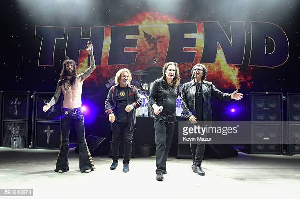 Tommy Clufetos Geezer Butler Ozzy Osbourne and Tony Iommi perform onstage as Black Sabbath on 'The End Tour' at Nikon at Jones Beach Theater on...