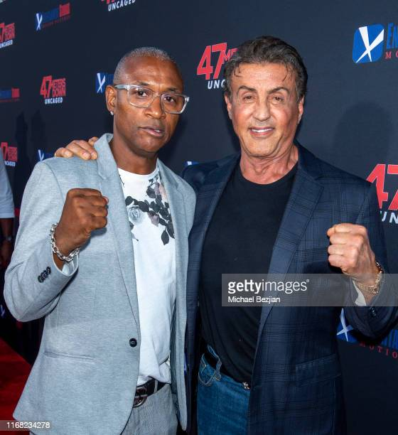 Tommy Davidson and Sylvester Stallone attend the LA Premiere of 47 Meters Down UNCAGED on August 13 2019 in Los Angeles California