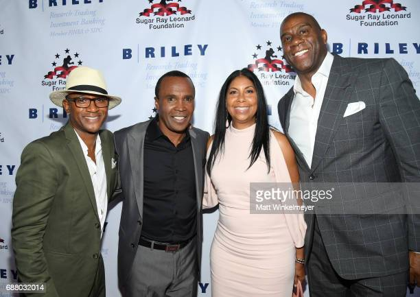 Tommy Davidson Sugar Ray Leonard Cookie Johnson and Magic Johnson attend the B Riley Co 8th Annual Big Fighters Big Cause Charity Boxing Night...