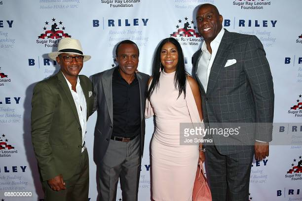 Tommy Davidson Sugar Ray Leonard Cookie Johnson and Magic Johnson attend the 8th Annual Big Fighters Big Cause Charity Boxing Night at the Loews...