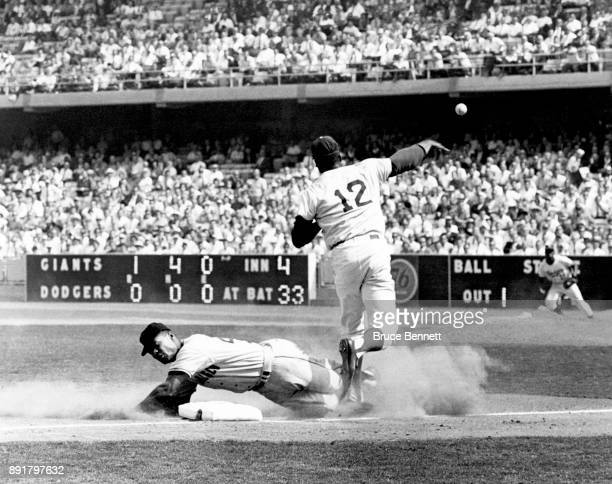 Tommy Davis of the Los Angeles Dodgers throws to first after stepping on the bag to get Felipe Alou of the San Francisco Giants out during an MLB...