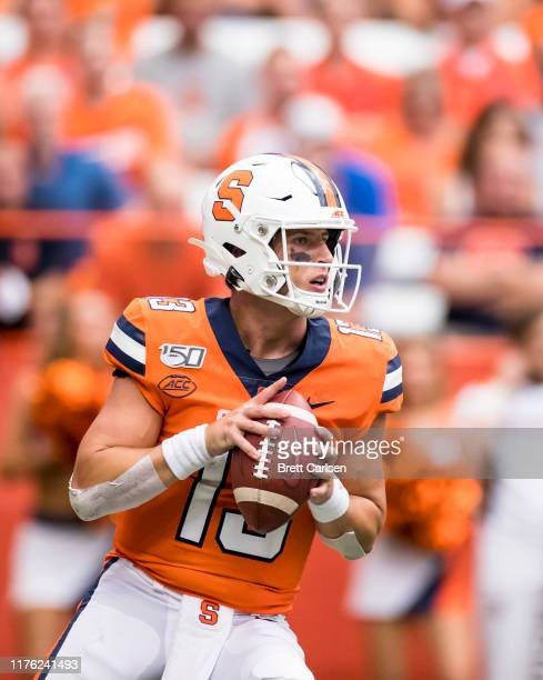 Tommy DeVito of the Syracuse Orange moves with the ball during the third quarter against the Western Michigan Broncos at the Carrier Dome on...