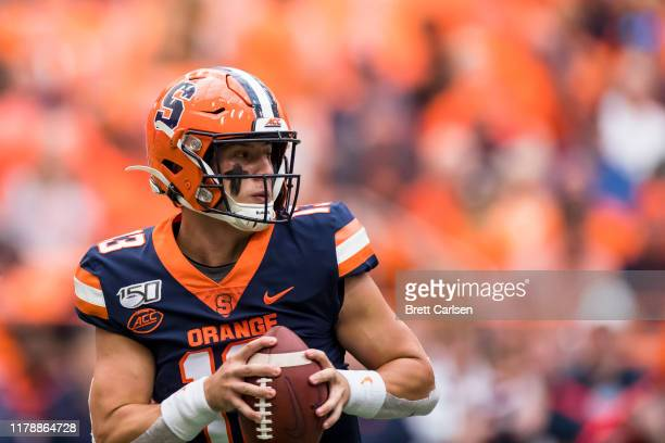 Tommy DeVito of the Syracuse Orange moves with the ball during the game against the Holy Cross Crusaders at the Carrier Dome on September 28 2019 in...