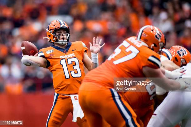Tommy DeVito of the Syracuse Orange passes the ball for a touchdown to Trishton Jackson during the first quarter against the Boston College Eagles at...