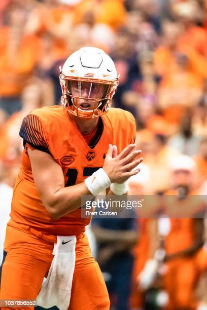 Tommy DeVito of the Syracuse Orange readies for a snap during the second half against the Florida State Seminoles at the Carrier Dome on September 15...