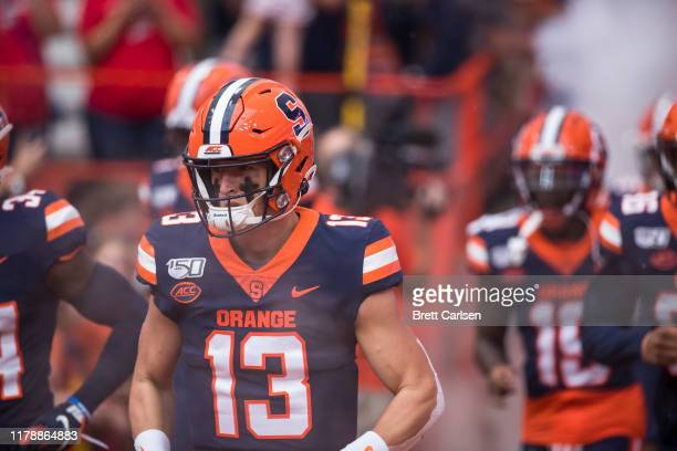 Tommy DeVito of the Syracuse Orange runs out of the tunnel before the game against the Holy Cross Crusaders at the Carrier Dome on September 28 2019...