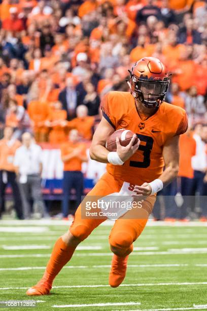 Tommy DeVito of the Syracuse Orange runs with the ball during overtime against the North Carolina Tar Heels at the Carrier Dome on October 20 2018 in...