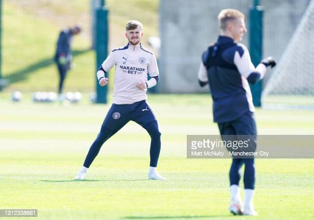 Tommy Doyle of Manchester City in action during a training session at Manchester City Football Academy on April 13, 2021 in Manchester, England.