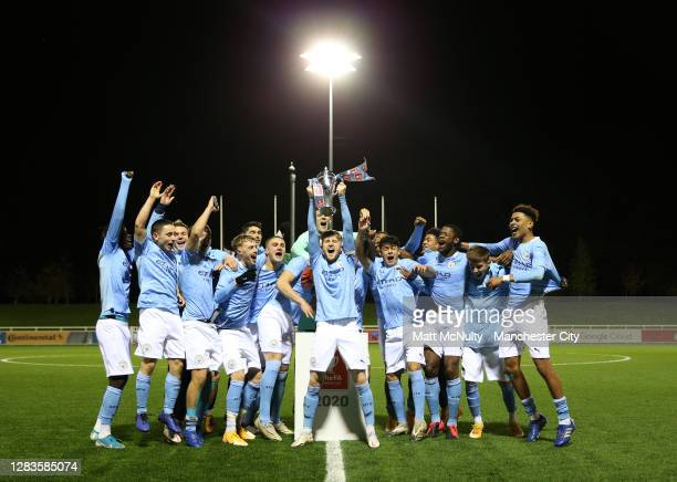 Tommy Doyle of Manchester City lifts the FA Youth Cup trophy with his teammates following the FA Youth Cup Final match between Manchester City and...