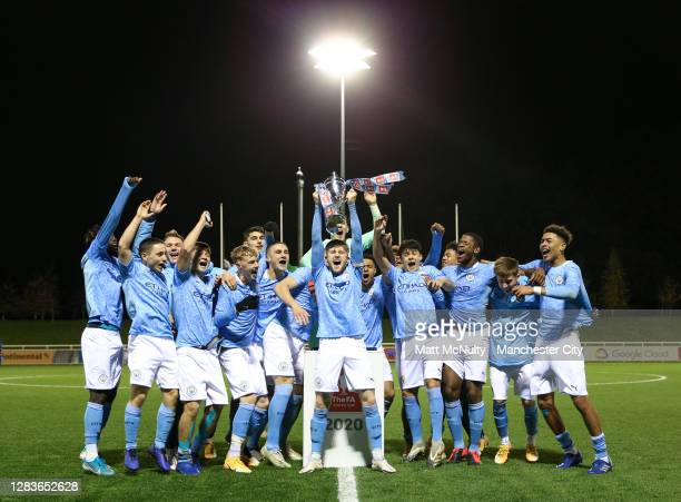 Tommy Doyle of Manchester City lifts the FA Youth Cup trophy with his team mates during the FA Youth Cup Final match between Manchester City and...