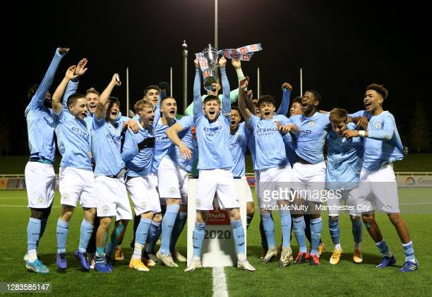 Tommy Doyle of Manchester City lifts the FA Youth Cup trophy with teammates following the FA Youth Cup Final match between Manchester City and...