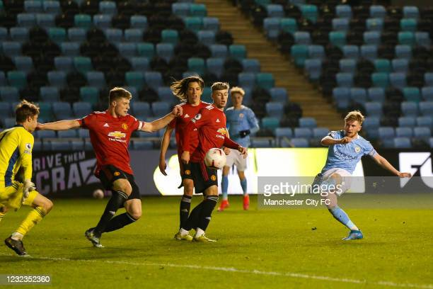 Tommy Doyle of Manchester City shoots the ball during the Premier League 2 match against Manchester United at Manchester City Football Academy on...