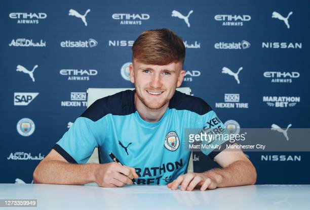 Tommy Doyle of Manchester City signs a contract extension at Manchester City Football Academy on September 18, 2020 in Manchester, England.