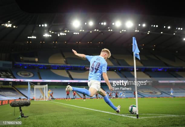 Tommy Doyle of Manchester City takes a corner kick during the Carabao Cup third round match between Manchester City and AFC Bournemouth at Etihad...