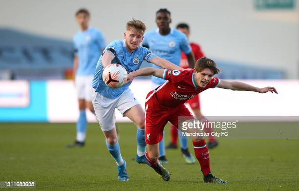 Tommy Doyle of Manchester City U23 beats Leighton Clarkson of Liverpool U23 during the Premier League 2 match between Manchester City and Liverpool...