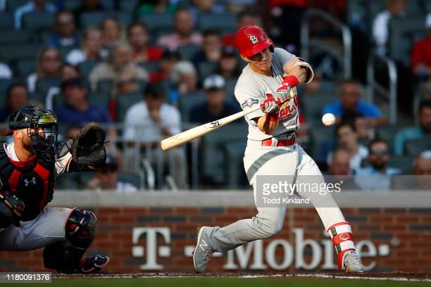 Tommy Edman of the St Louis Cardinals hits a triple against the Atlanta Braves during the second inning in game five of the National League Division...