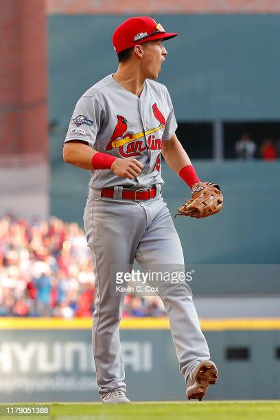 Tommy Edman of the St. Louis Cardinals reacts after tagging out Nick Markakis of the Atlanta Braves at third base on a steal attempt in the fourth...
