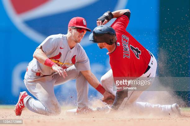 Tommy Edman of the St. Louis Cardinals tags out Bradley Zimmer of the Cleveland Indians attempting to steal second base during the seventh inning at...