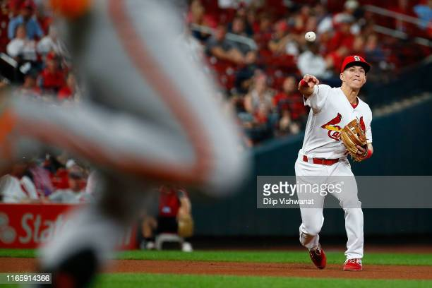 Tommy Edman of the St Louis Cardinals throws to first base against the San Francisco Giants in the seventh inning at Busch Stadium on September 3...