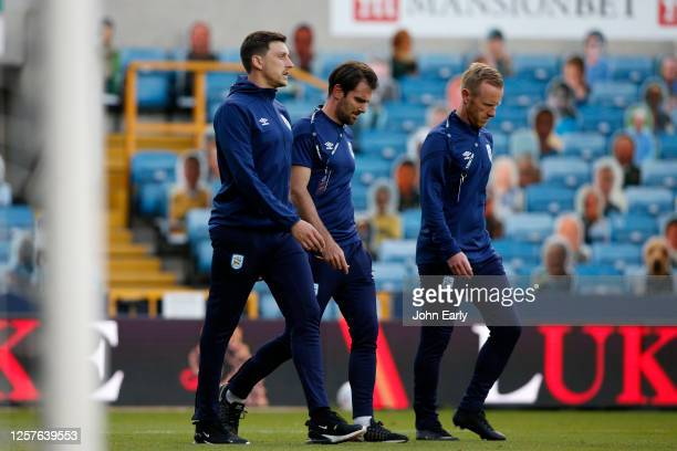 Tommy Elphick Danny Schofield the caretaker manager and Jon Worthington the caretaker assistant manager of Huddersfield Town during the Sky Bet...