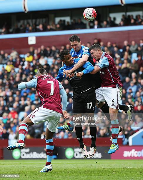 Tommy Elphick Joshua King of Bournemouth compete for the ball against Ciaran Clark and Leandro Bacuna of Aston Villa during the Barclays Premier...