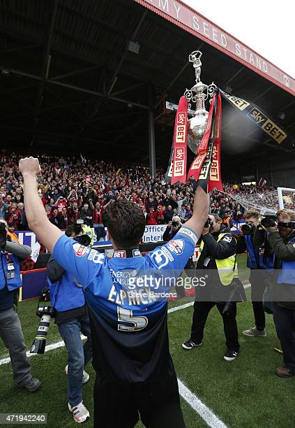Tommy Elphick of AFC Bournemouth celebrates with the trophy after winning the Championship during the Sky Bet Championship match between Charlton...